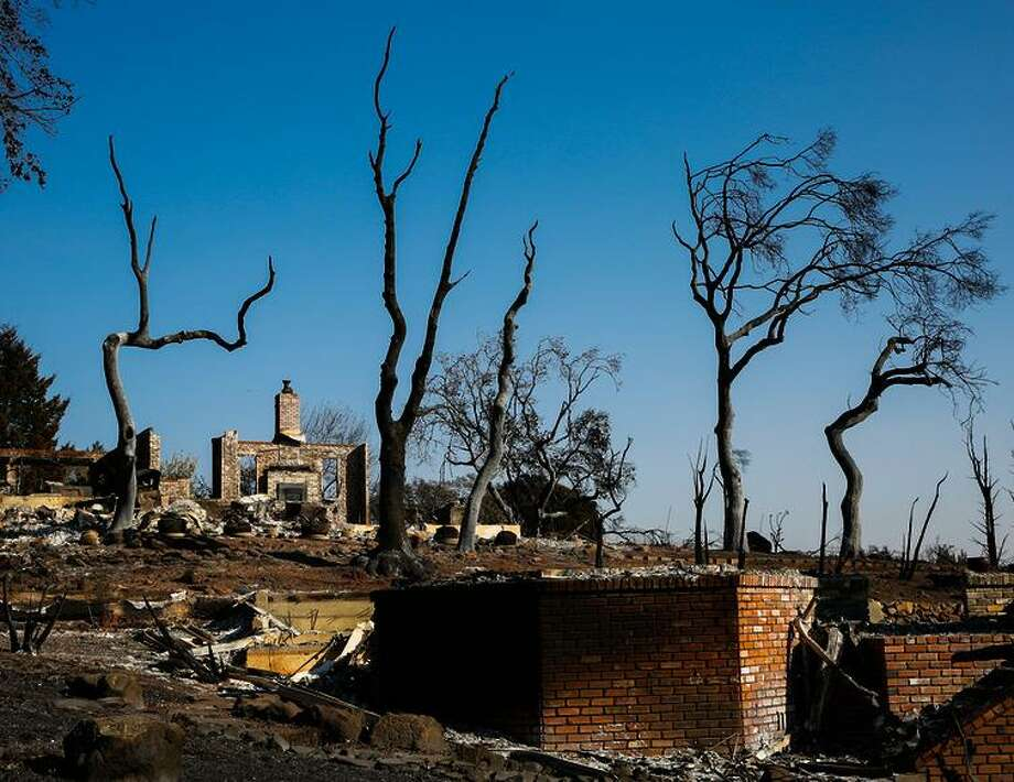 A chimney is all that remains after the Tubbs Fire ravaged the Fountaingrove neighborhood in Santa Rosa. The fire was 98 percent contained Sunday. Photo: Gabrielle Lurie / The Chronicle