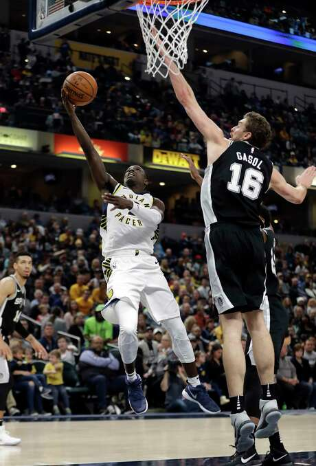 Indiana Pacers' Darren Collison, center, shoots against San Antonio Spurs' Pau Gasol, right, during the first half of an NBA basketball game, Sunday, Oct. 29, 2017, in Indianapolis. (AP Photo/Darron Cummings) Photo: Darron Cummings, Associated Press / Copyright 2017 The Associated Press. All rights reserved.