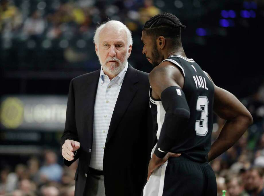 San Antonio Spurs head coach Gregg Popovich, left, talks with Brandon Paul during the first half of an NBA basketball game against the Indiana Pacers, Sunday, Oct. 29, 2017, in Indianapolis. (AP Photo/Darron Cummings) Photo: Darron Cummings, Associated Press / Copyright 2017 The Associated Press. All rights reserved.