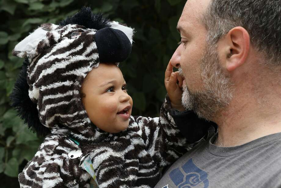 Kai Broadwater, 1 1/2, in his zebra costume, enjoys the Oakland Boo at the Zoo event with his father Noah Broadwater. Photo: Craig Lee, Special To The Chronicle