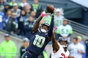 Seattle Seahawks wide receiver Paul Richardson (10) makes a 48-yard catch against Houston Texans strong safety Marcus Gilchrist (21) during the wining drive at CenturyLink Field Sunday, Oct. 29, 2017, in Seattle. The Seahawks won 41-38.