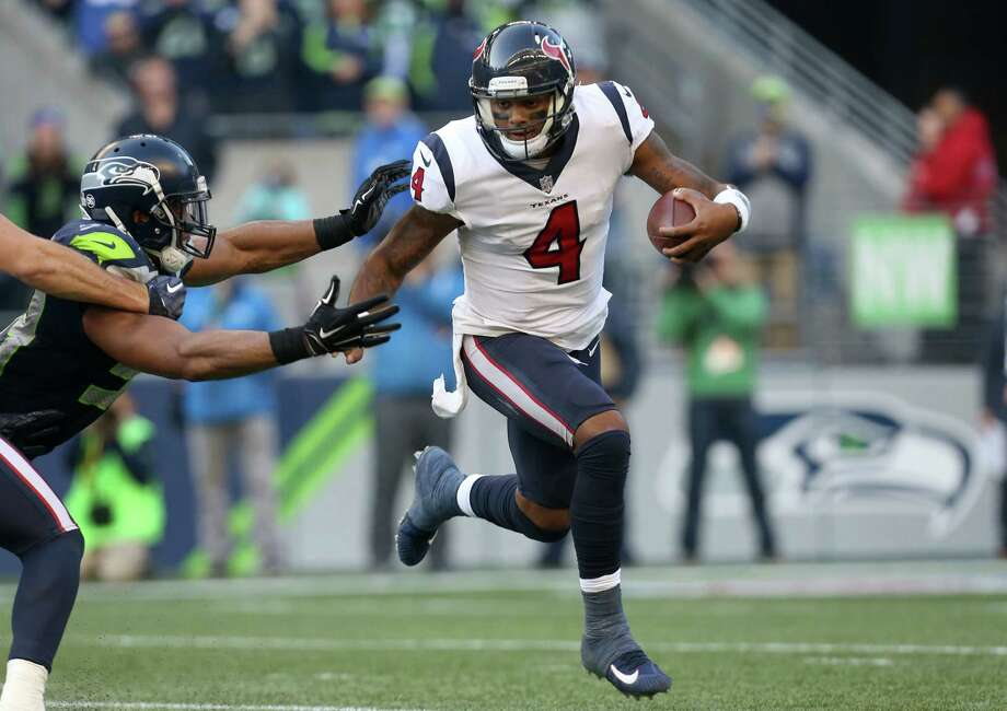 Houston Texans quarterback Deshaun Watson (4) evades the pressure by Seattle Seahawks middle linebacker Bobby Wagner (54) during the third quarter of the game at CenturyLink Field Sunday, Oct. 29, 2017, in Seattle. The Seahawks won 41-38. Photo: Godofredo A. Vasquez, Houston Chronicle / Godofredo A. Vasquez