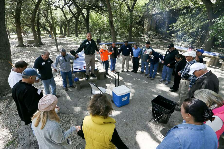 Attendees pray during the 50th reunion of the Alamo Heights Youth Development Program, which was designed for boys ages 7 to 15. Photo: Marvin Pfeiffer / San Antonio Express-News / Express-News 2017