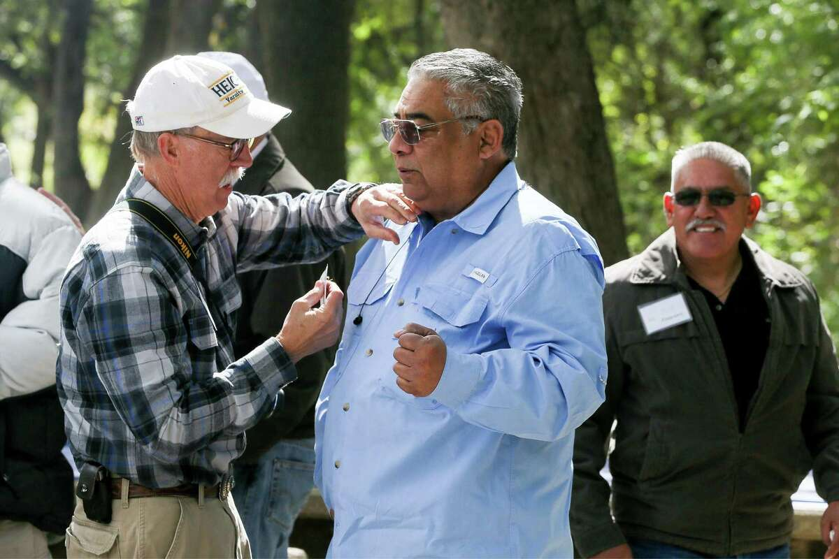 Mac Sykees (left) pins a name tag on Albert Perales during the 50th reunion of the Alamo Heights Youth Development Program, a summer recreation program for low-income Hispanic kids in Cementville, in Olmos Park on Oct. 28. The program, started in 1967 by Sykes and Tony Arevalo, two Alamo Heights Mules football players, lasted for about six years but the friendships that were forged in the student-run program have lasted a lifetime.