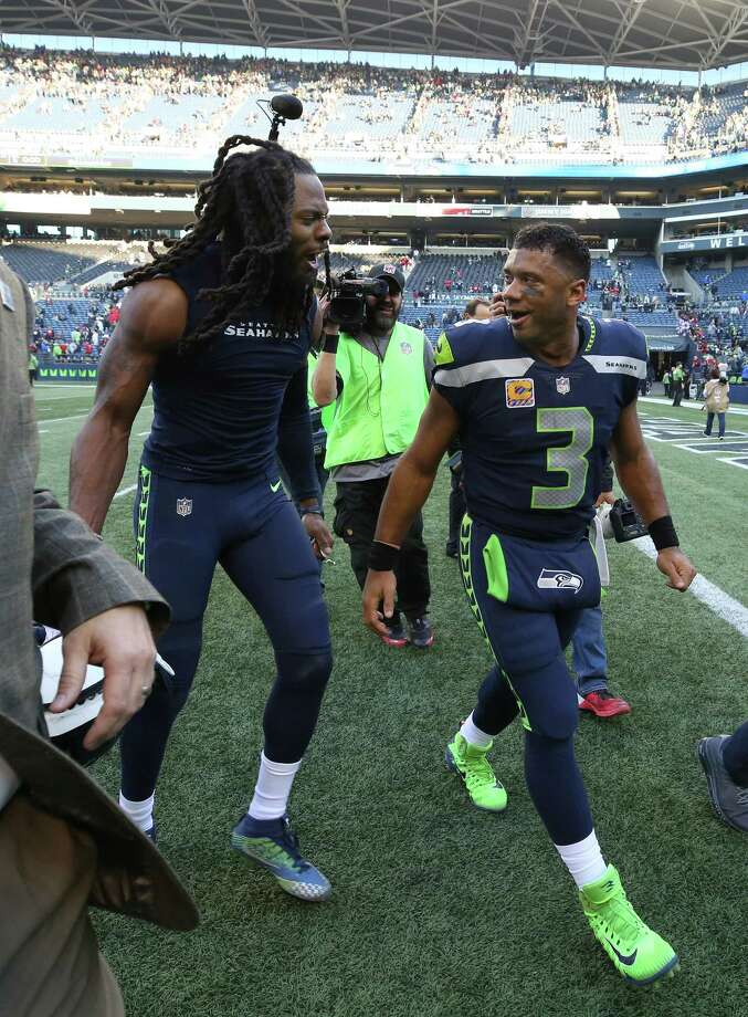 Seattle Seahawks cornerback Richard Sherman (25) and  quarterback Russell Wilson (3) celebrate after the game against the Houston Texans at CenturyLink Field Sunday, Oct. 29, 2017, in Seattle. The Seahawks won 41-38. Photo: Godofredo A. Vasquez, Houston Chronicle / Godofredo A. Vasquez
