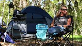 Stephen Meier evacuated to McKinney Falls State Park when Hurricane Harvey hit. Since then, Meier and his dog, Peck-Peck, have been living there for free.