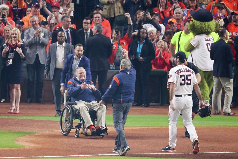 Former president George H.W. Bush, left, claps after his son, former president George W. Bush, threw out the first pitch to Houston Astros starting pitcher Justin Verlander (35) before the Houston Astros take on the Los Angeles Dodgers in Game 5 of the World Series at Minute Maid Park Sunday, Oct. 29, 2017 in Houston. Photo: Michael Ciaglo, Houston Chronicle / Michael Ciaglo