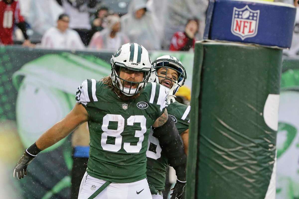 New York Jets' Eric Tomlinson (83) celebrates with teammate Austin Seferian-Jenkins after scoring a touchdown during the first half of an NFL football game against the Atlanta Falcons, Sunday, Oct. 29, 2017, in East Rutherford, N.J. (AP Photo/Seth Wenig) ORG XMIT: ERU103
