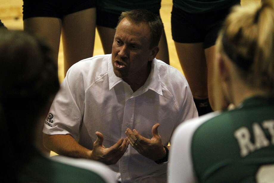 FOR SPORTS - Reagan head coach Mike Carter speaks to his team during a timeout during the Region IV-5A volleyball semifinals against Alexander at Greehey Arena at St. Mary's University on Friday, Nov. 11, 2011. Reagan won in straight sets. MICHAEL MILLER / mmiller@express-news.net Photo: MICHAEL MILLER, STAFF / SAN ANTONIO EXPRESS-NEWS / mmiller@express-news.net
