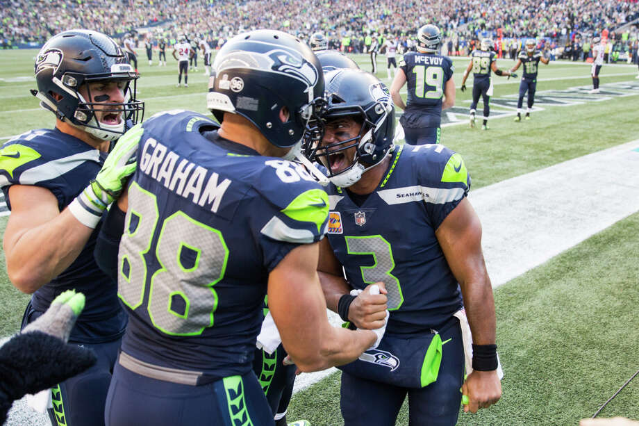 Seahawks quarterback Russell Wilson celebrates tight end Jimmy Graham's game-winning catch during the second half of an NFL game against the Texans at CenturyLink Field on Sunday, Oct. 29, 2017. Photo: GRANT HINDSLEY, SEATTLEPI.COM / SEATTLEPI.COM