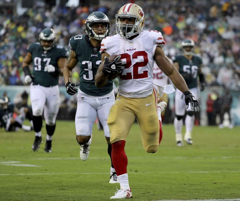 Matt Breida speeds toward the end zone after catching a shovel pass. His 21-yard reception resulted in his first NFL touchdown. Photo: Abbie Parr / Abbie Parr / Getty Images / 2017 Getty Images