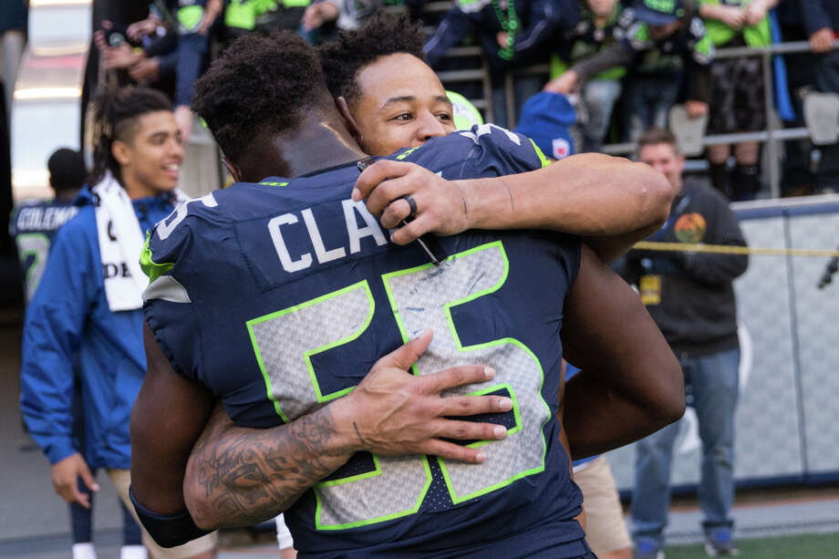 Seahawks safety Earl Thomas hugs defensive lineman Frank Clark following Seattle's 41-38 win over the Texans at CenturyLink Field on Sunday, Oct. 29, 2017. Photo: GRANT HINDSLEY, SEATTLEPI.COM / SEATTLEPI.COM