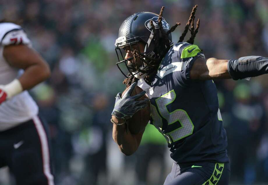 Seattle Seahawks cornerback Richard Sherman (25) runs with the ball after intercepting Houston Texans quarterback Deshaun Watson (4) during the second half of the game at CenturyLink Field Sunday, Oct. 29, 2017, in Seattle. The Seahawks won 41-38. Photo: Godofredo A. Vasquez, Houston Chronicle / Godofredo A. Vasquez