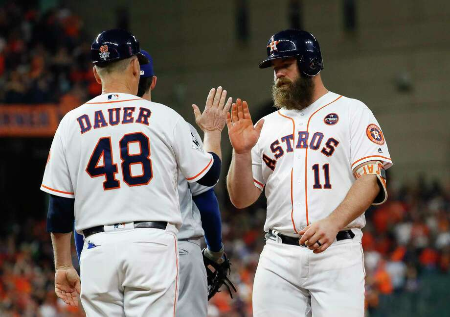 The Astros and designated hitter/catcher Evan Gattis avoided a salary arbitration hearing by settling Friday on a 2018 salary worth $6.7 million.  Photo: Karen Warren, Houston Chronicle / © 2017 Houston Chronicle