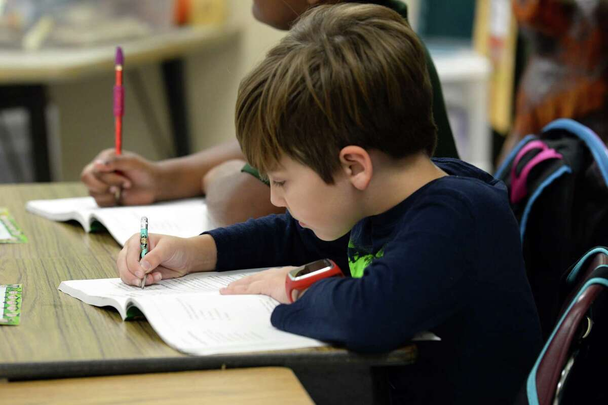 Calder Vercher, 9, works in his test preparation book Friday at Little Cypress Intermediate School in Orange. The Little Cypress-Mauriceville CISD has asked for $209,000 worth of textbooks on the registry for Harvey-affected districts.