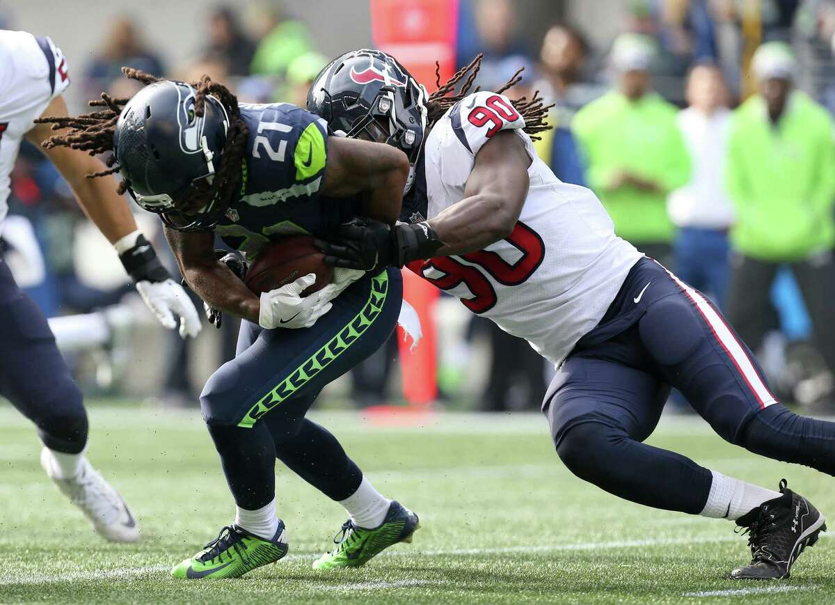 Houston Texans outside linebacker Jadeveon Clowney (90) tackles Seattle Seahawks runningback J.D. McKissic (21) during the first half of the game at CenturyLink Field Sunday, Oct. 29, 2017, in Seattle. The Seahawks won 41-38.