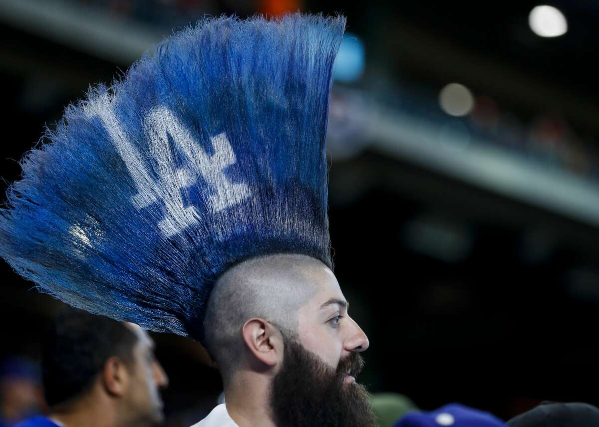 A Corpus Christi law firm is looking for Yankees and Dodgers fans, like this one at Game 5 of the 2017 World Series at Minute Maid Park, to join sign stealing-related lawsuits against the Astros.