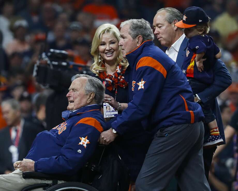 Former Presidents George H.W. Bush and George W. Bush leave the field after throwing out the ceremonial first pitch before Game 5 of the World Series at Minute Maid Park on Sunday, Oct. 29, 2017, in Houston. Photo: Karen Warren/Houston Chronicle