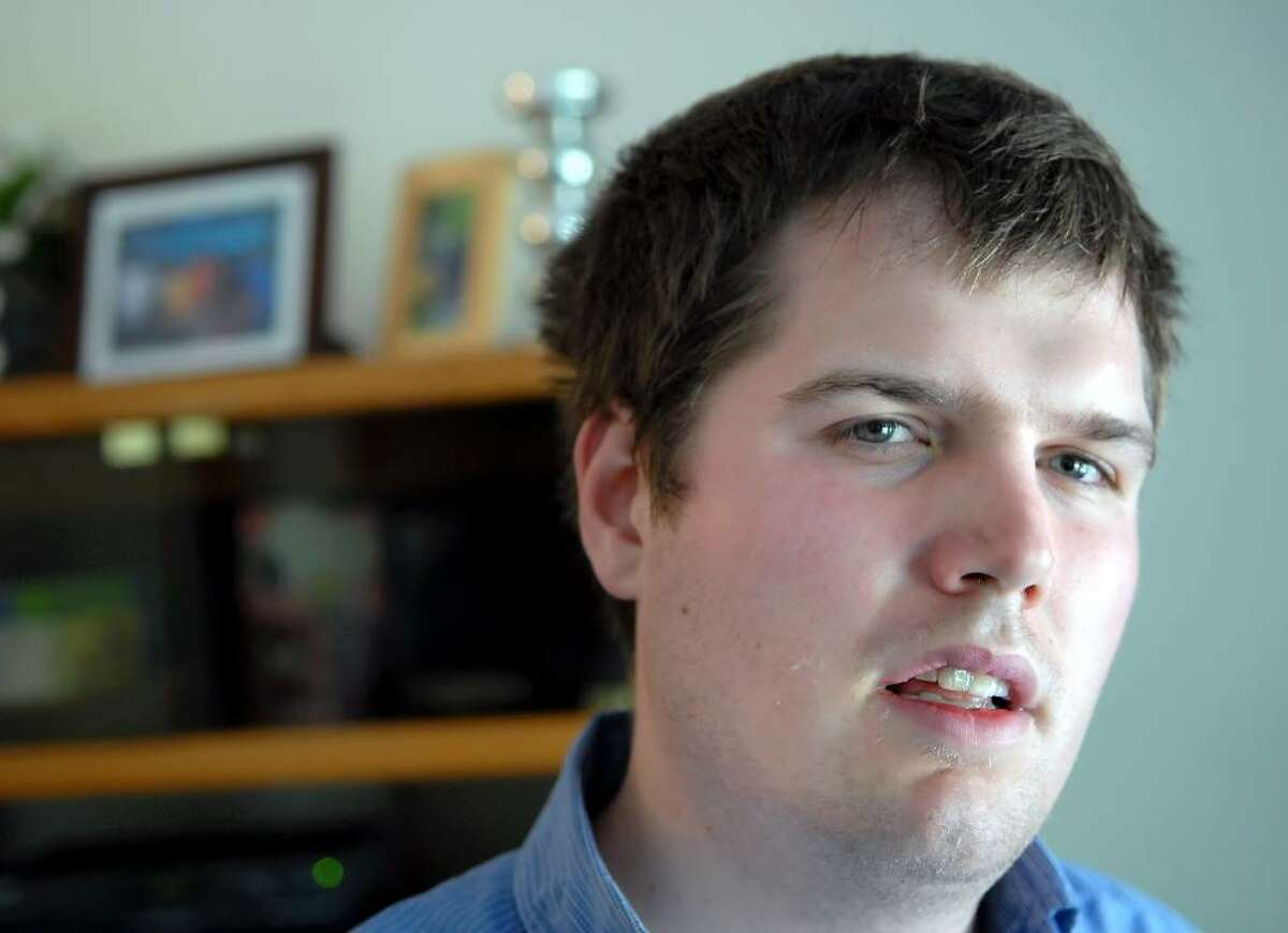 Sean Stuart, 24, posed at the Abilis group home in Cos Cob where he is a resident, Friday afternoon, June 25, 2010. Stuart is autistic.