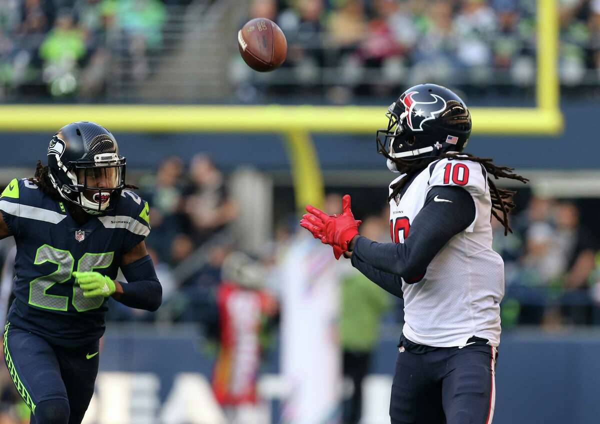 Houston Texans wide receiver DeAndre Hopkins (10) makes a catch against Seattle Seahawks cornerback Shaquill Griffin (26) during the second half of the game at CenturyLink Field Sunday, Oct. 29, 2017, in Seattle. The Seahawks won 41-38.