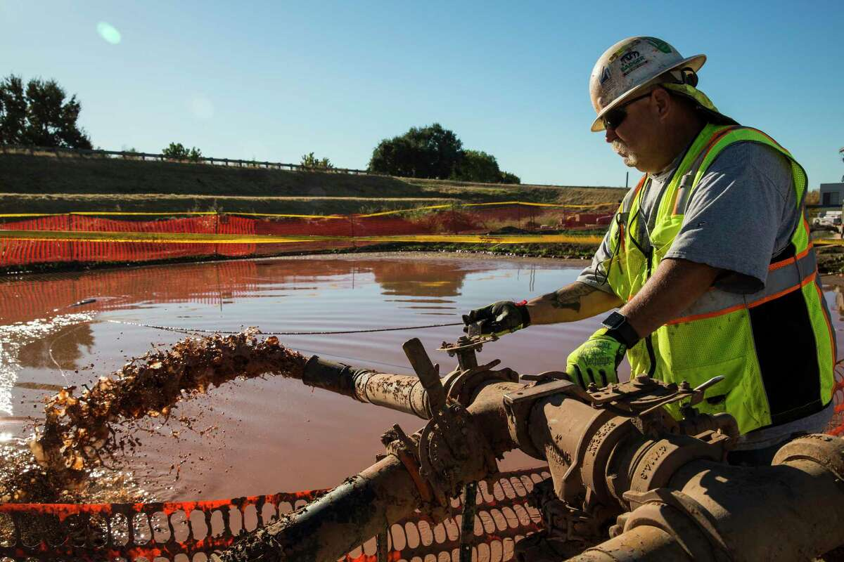 Charles Seipel, a senior batch plant operator, mixes a bentonite clay solution that will be used to create a retaining wall at the construction site of the Southport setback levee in West Sacramento, Calif.