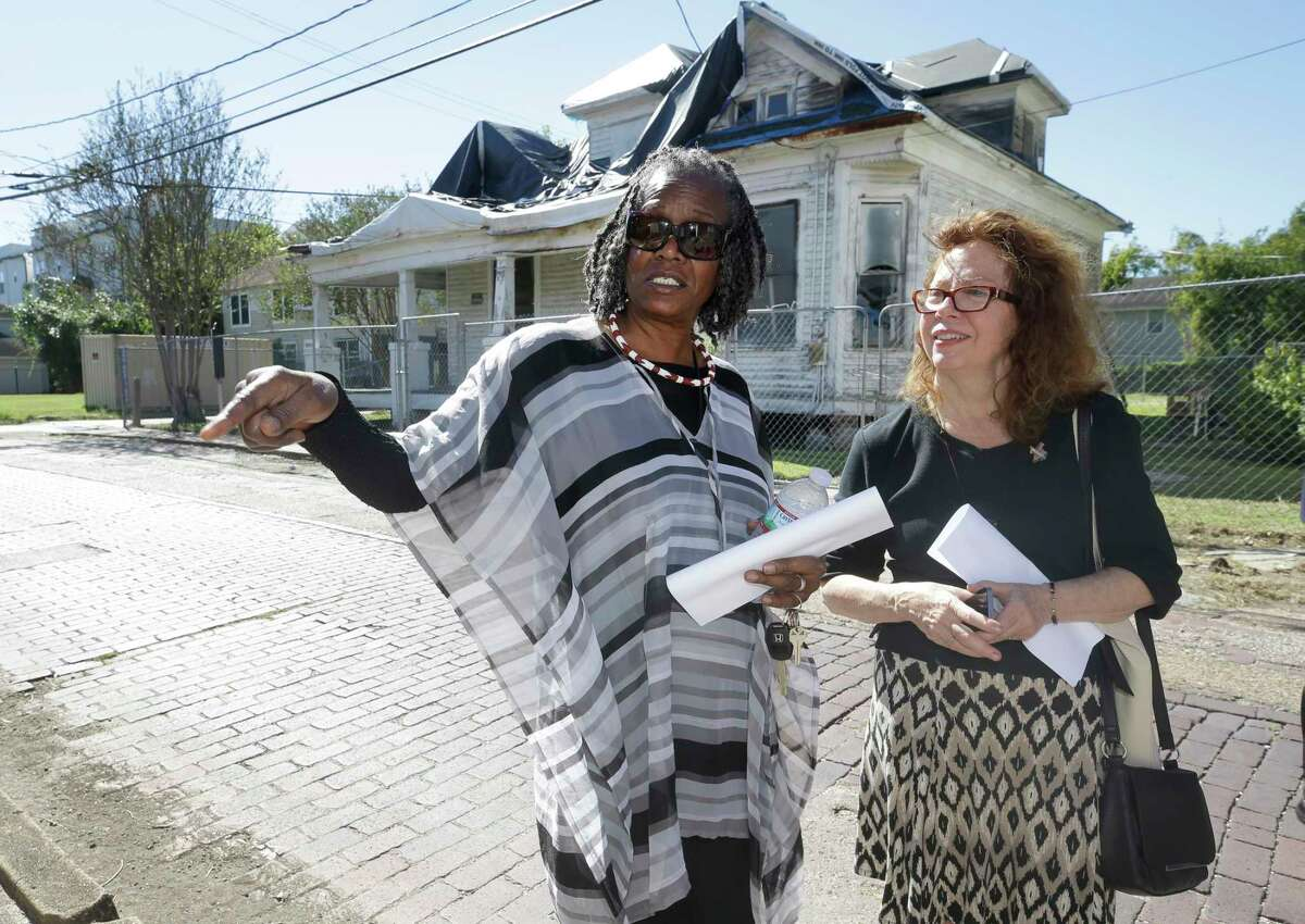 Sarah Trotty, left, and Jane Landers, a UNESCO slave-route project representative, right, talk as they walk on the historic bricks on Wilson St. during tour of Freedmen's Town in Houston.
