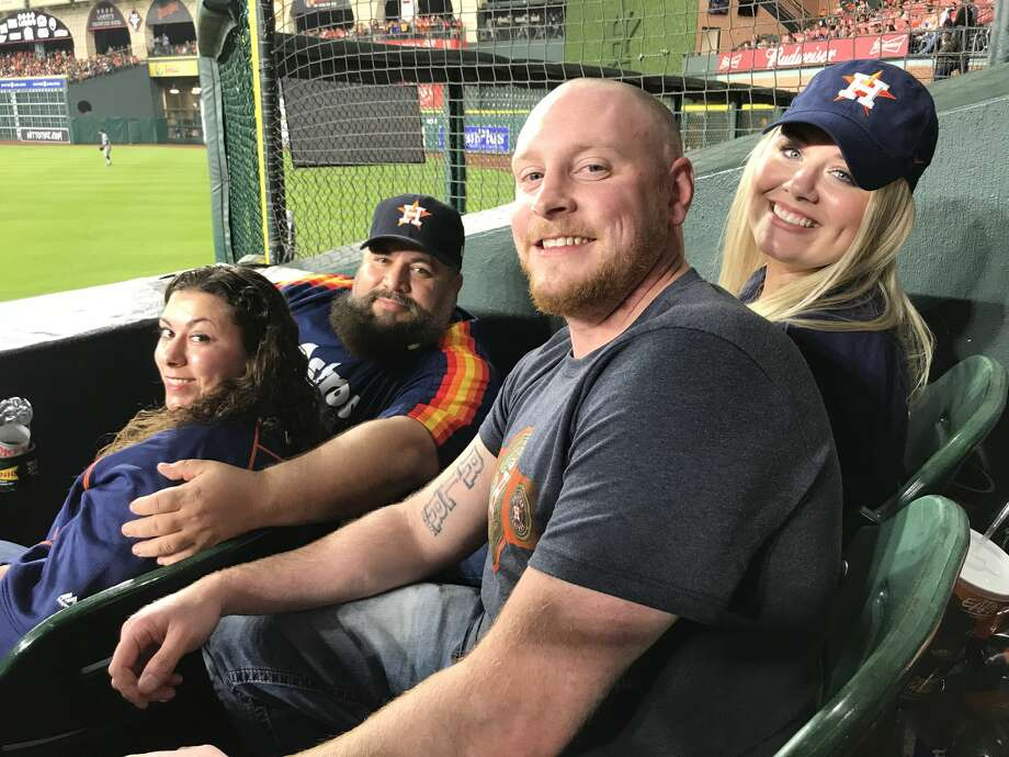 Micah Reinhardt (center) ended up with Cody Bellinger's fifth-inning home run ball. Micah went to the game with his wife Jessica Reinhardt (far right). The home run ball glanced off Rachelle Hernandez (front) and her husband Ernie Hernandez jokingly said he would have made Reinhardt throw back the other team's home run ball anyway. Photo: Matt Young