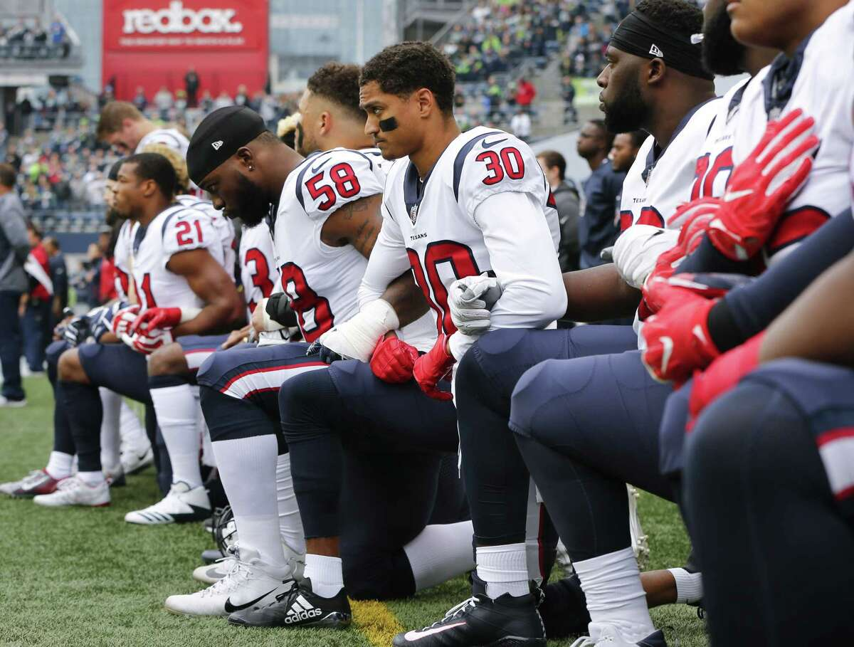All but about 10 Texans players knelt during the national anthem before their game Sunday, Oct. 29, 2017 at Seattle in a simple protest over owner Bob McNair's remarks.