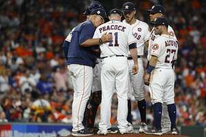 Houston Astros pitching coach Brent Strom (56) visits the mound to talk to relief pitcher Brad Peacock during the seventh inning of Game 5 of the World Series at Minute Maid Park on Sunday, Oct. 29, 2017, in Houston.