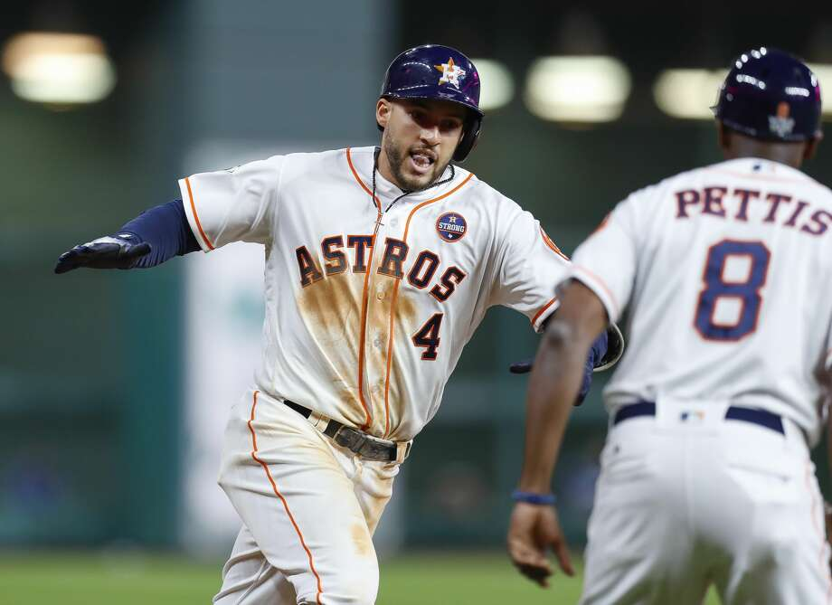 Houston Astros center fielder George Springer (4) rounds third after hitting a solo home run to lead off the seventh inning of Game 5 of the World Series at Minute Maid Park on Sunday, Oct. 29, 2017, in Houston. Photo: Brett Coomer/Houston Chronicle