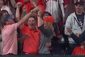 Kirk Head (left) ripped the home run ball out of his sister-in-law Sarah Head's hands and threw it back onto the field in the ninth inning of Game 5 of the World Series on Sunday night.   Here are a few shots of another awesome fan catch from the postseason, featuring Langham Creek Grad, John Michael Sopher-->