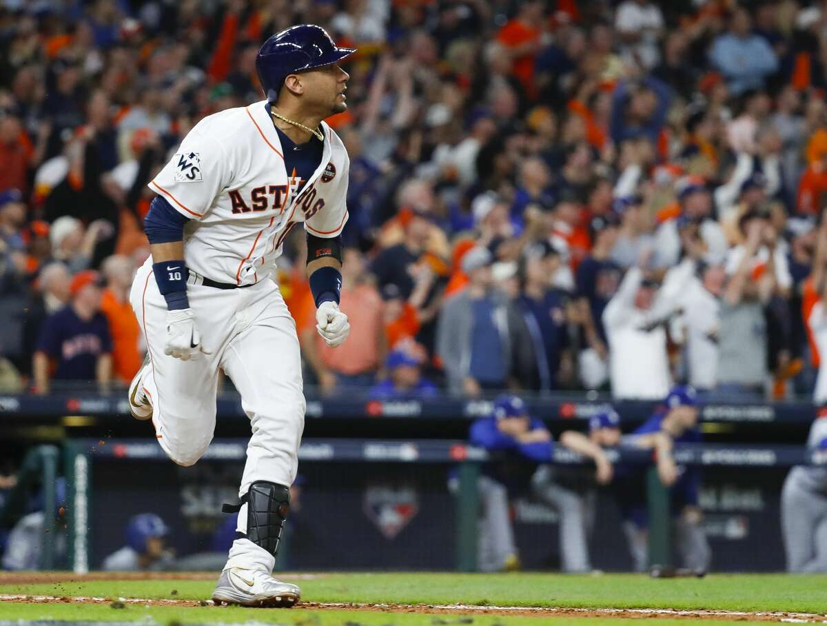 Houston Astros first baseman Yuli Gurriel (10) hits a double during the ninth inning of Game 5 of the World Series at Minute Maid Park on Monday, Oct. 30, 2017, in Houston.