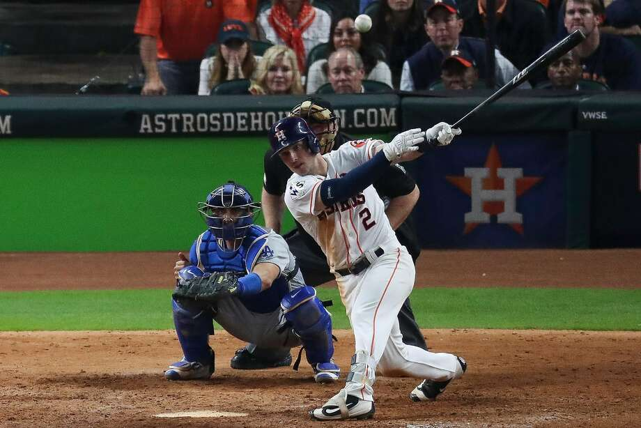 Houston's Alex Bregman connects for a single to left off Kenley Jansen, driving in pinch-runner Derek Fisher with the winning run in the 10th inning of Game 5. Photo: Michael Ciaglo, Houston Chronicle