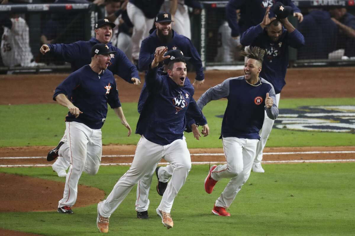 Houston Astros relief pitcher Joe Musgrove (59) and first baseman Yuli Gurriel (10) celebrate as they beat the Los Angeles Dodgers 13-12 in Game 5 of the World Series at Minute Maid Park Monday, Oct. 30, 2017 in Houston.
