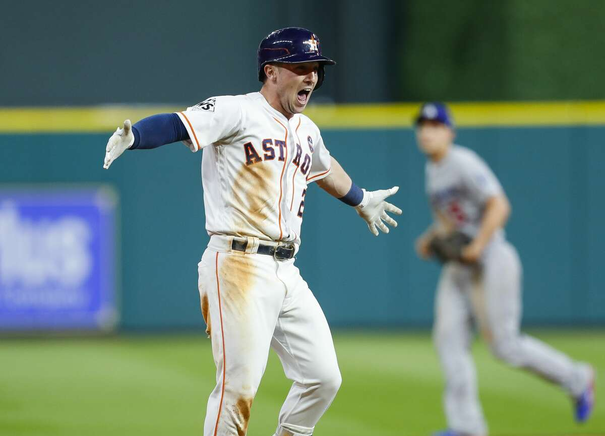 Houston Astros third baseman Alex Bregman (2) celebrates his walk off single that drove in left fielder Derek Fisher (21) to give the Astros a 13-12 victory over the Los Angeles Dodgers in the tenth inning of Game 5 of the World Series at Minute Maid Park on Monday, Oct. 30, 2017, in Houston.