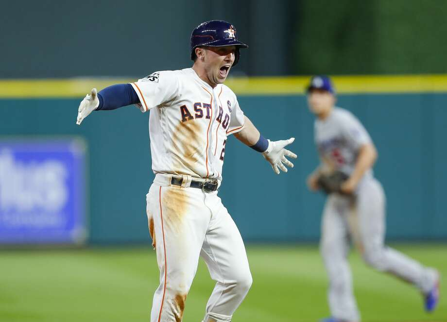 Houston Astros third baseman Alex Bregman (2) celebrates his walk off single that drove in left fielder Derek Fisher (21) to give the Astros a 13-12 victory over the Los Angeles Dodgers in the tenth inning of Game 5 of the World Series at Minute Maid Park on Monday, Oct. 30, 2017, in Houston.  Photo: Brett Coomer/Houston Chronicle
