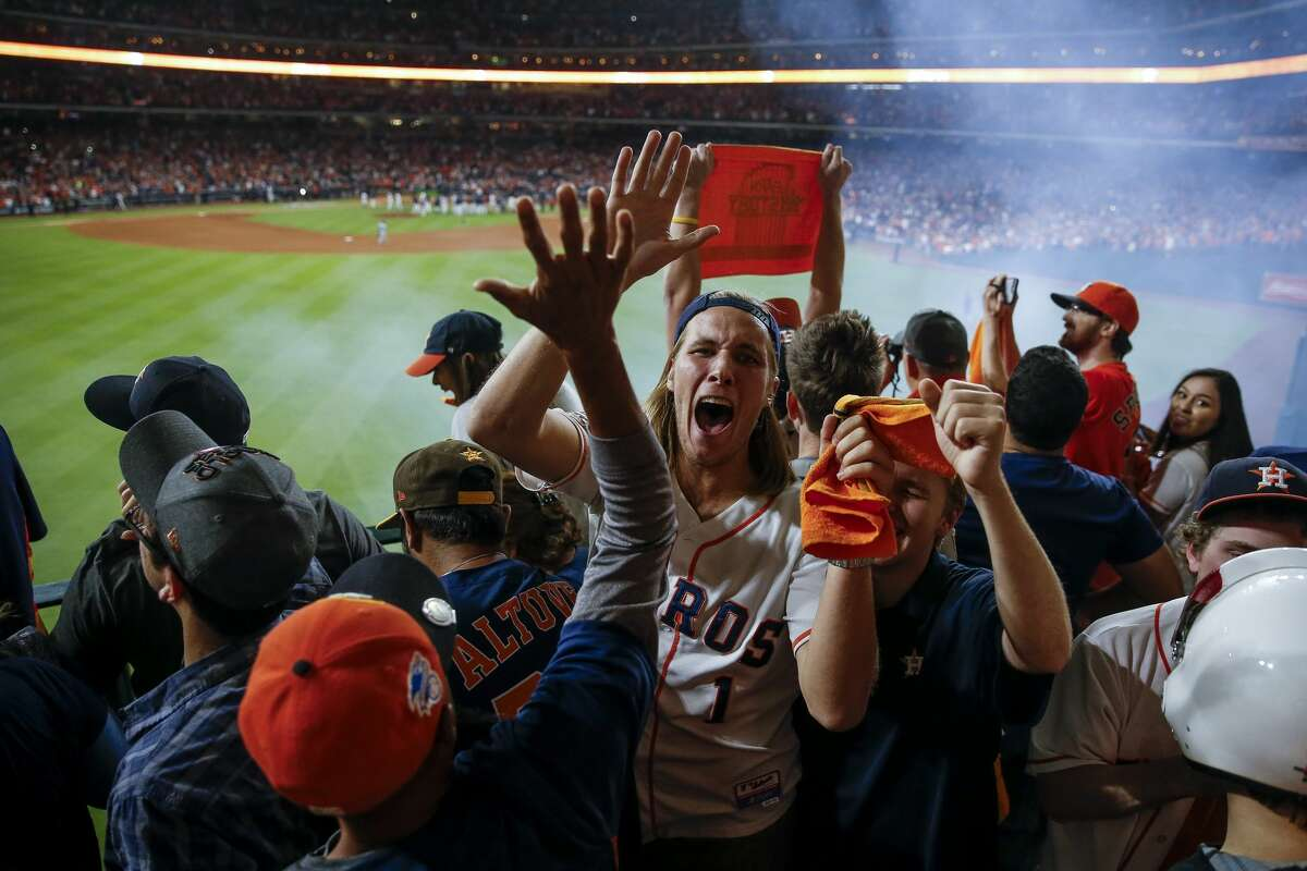 Fans celebrate after the tenth inning as the Houston Astros beat the Los Angeles Dodgers 13-12 in Game 5 of the World Series at Minute Maid Park Monday, Oct. 30, 2017 in Houston.