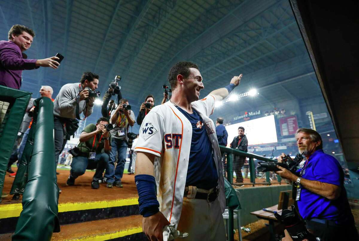 Houston Astros third baseman Alex Bregman (2) enters the Astros dugout after hitting a walk off single that drove in pinch runner Derek Fisher and gave the Astros a 13-12 win over the Los Angeles Dodgers in the tenth inning of Game 5 of the World Series at Minute Maid Park on Monday, Oct. 30, 2017, in Houston.