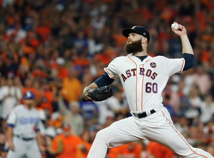 Houston Astros starting pitcher Dallas Keuchel (60) pitches in the first inning of Game 5 of the World Series at Minute Maid Park on Sunday, Oct. 29, 2017, in Houston.  ( Karen Warren  / Houston Chronicle )