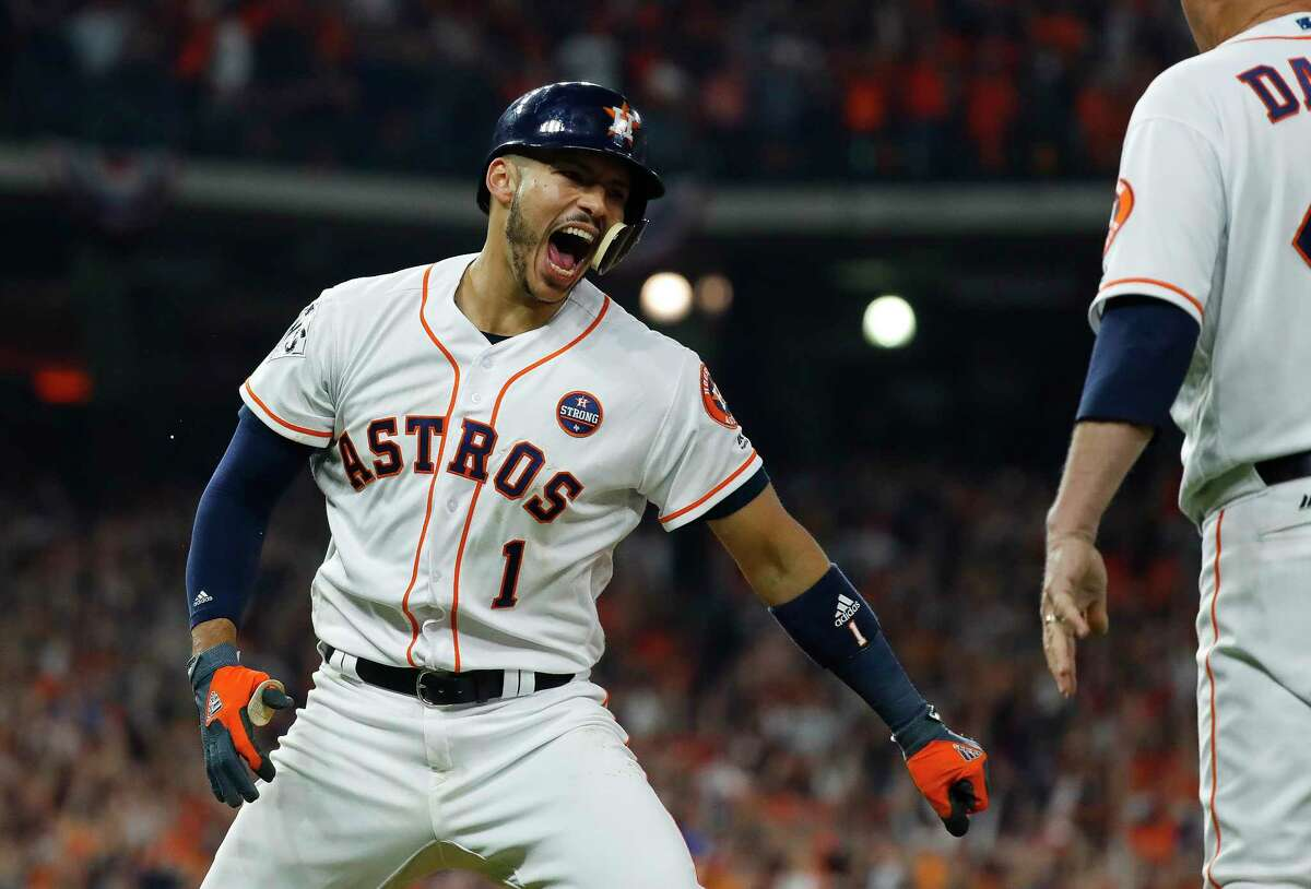 Astros shortstop Carlos Correa celebrates his two-run home run that drove in Jose Altuve during the seventh inning of Game 5 of the World Series.
