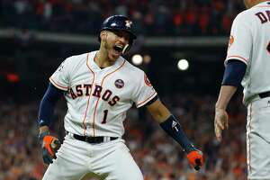 Astros shortstop Carlos Correa celebrates his two-run home run that drove in Jose Altuve during the seventh inning of Game 5 of the World Series on Sunday night.
