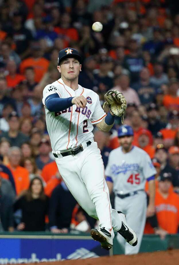 Houston Astros third baseman Alex Bregman (2) throws out Los Angeles Dodgers center fielder Chris Taylor (3) during the second inning of Game 5 of the World Series at Minute Maid Park on Sunday, Oct. 29, 2017, in Houston. ( Karen Warren  / Houston Chronicle ) Photo: Karen Warren, Staff / © 2017 Houston Chronicle