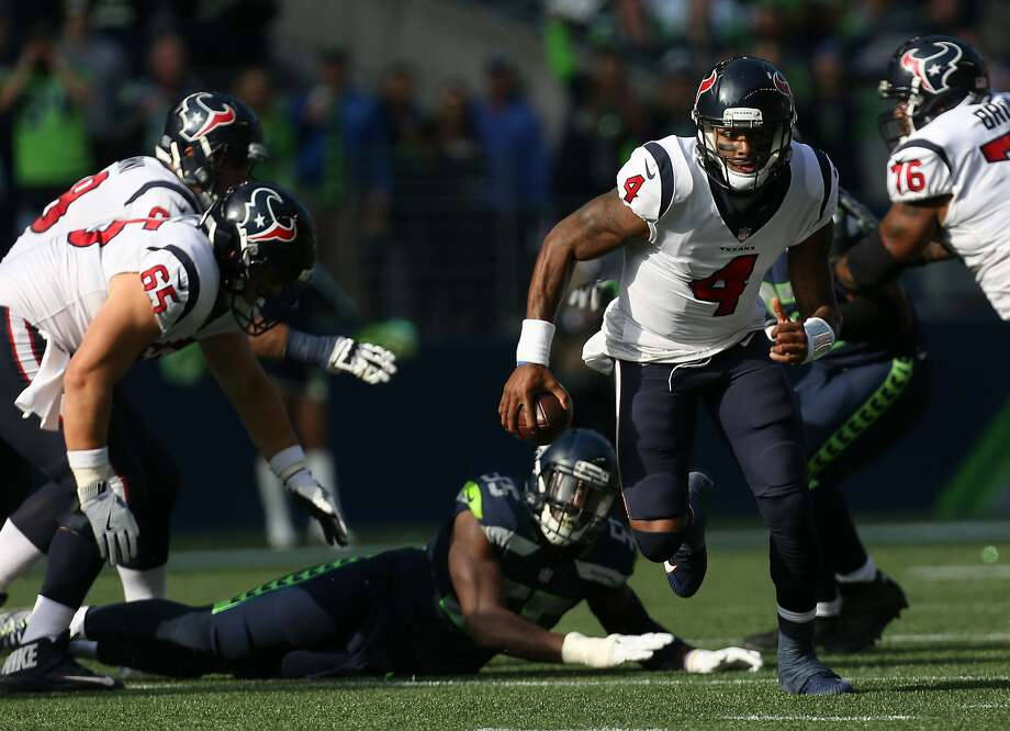 Houston Texans quarterback Deshaun Watson (4) scrambles out of the pocket against the Seattle Seahawks during the first half of the game at CenturyLink Field Sunday, Oct. 29, 2017, in Seattle. Photo: Godofredo A. Vasquez, Houston Chronicle