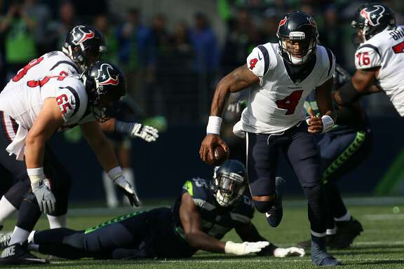 Houston Texans quarterback Deshaun Watson (4) scrambles out of the pocket against the Seattle Seahawks during the first half of the game at CenturyLink Field Sunday, Oct. 29, 2017, in Seattle. The Seahawks won 41-38. ( Godofredo A. Vasquez / Houston Chronicle )