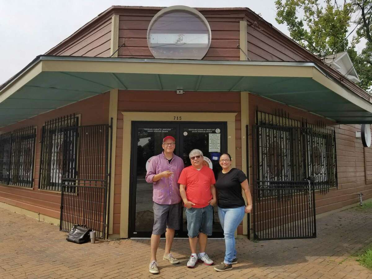 John and Veronica flank Gary Nguyen who owns the property at 715 Henderson that will become the Avila's Henderson & Kane General Store.