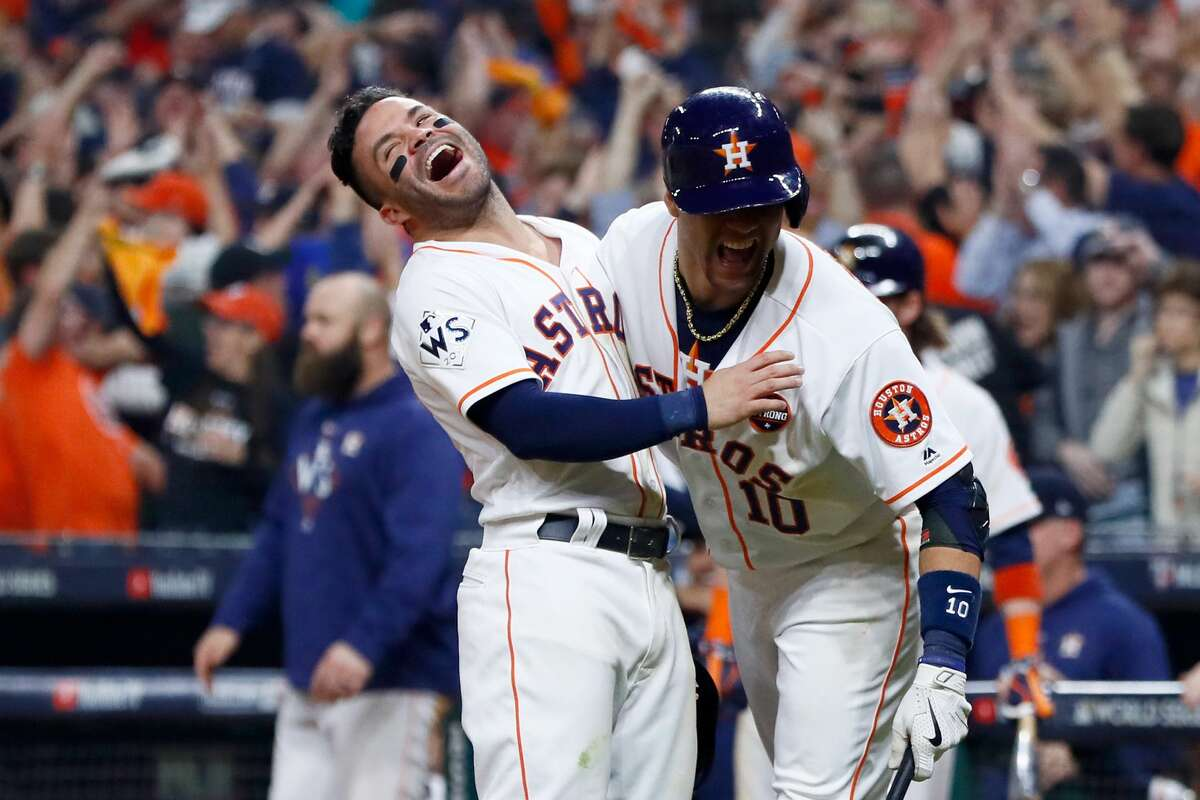 Jose Altuve #27 and Yuli Gurriel #10 of the Houston Astros celebrate after a two-run home run by Carlos Correa #1 (not pictured) during the seventh inning against the Los Angeles Dodgers in game five of the 2017 World Series at Minute Maid Park on October 29, 2017 in Houston, Texas.