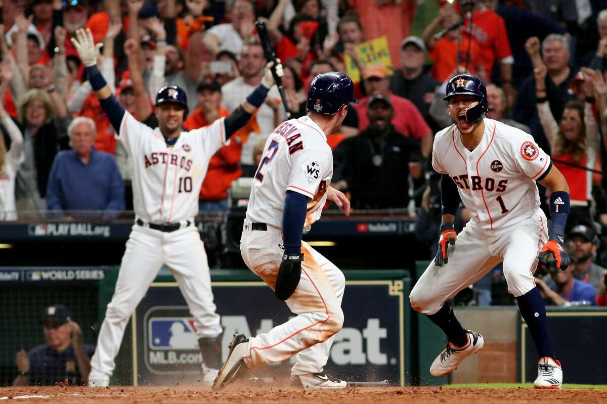 Alex Bregman #2 of the Houston Astros celebrates after scoring on a double by Jose Altuve #27 (not pictured) during the seventh inning against the Los Angeles Dodgers in game five of the 2017 World Series at Minute Maid Park on October 29, 2017 in Houston, Texas.