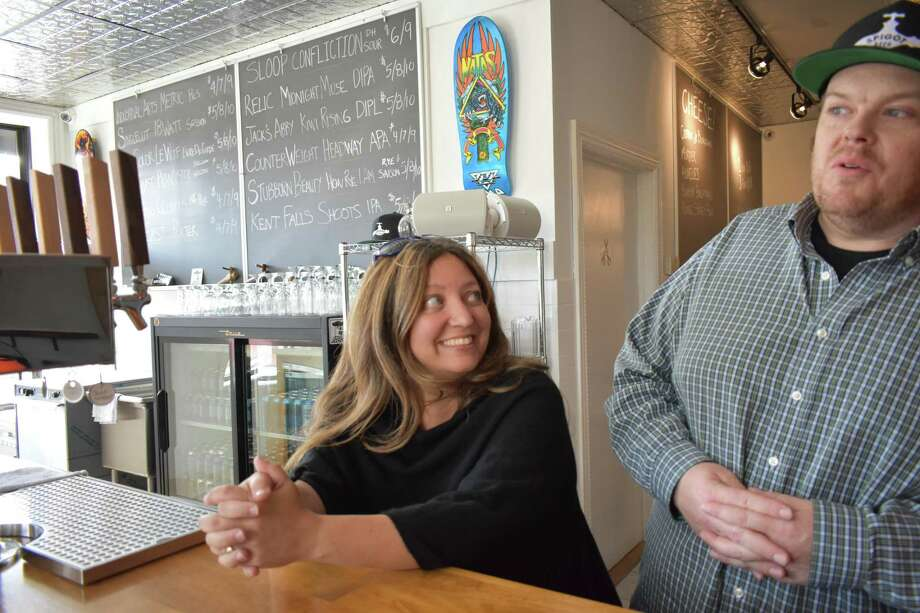 Jennie Bedusa and Smith Reynolds at their new Spigot Beer in South Norwalk, Conn., which features a daily menu of rarer brews as well as fine cheeses from Murray's in New York City. Photo: Alexander Soule / Hearst Connecticut Media / Stamford Advocate
