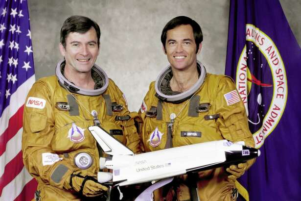 Commander John W. Young, left, and Pilot Robert L. Crippen, right, are pictured. Crippen  piloted the first orbital test flight of the Shuttle Columbia, the first true manned spaceship in 1981.