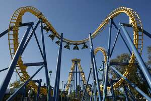 """California's Great America in Santa Clara, Calif., one of their featured thrill rides, """"Invertigo"""", roller coaster twists and turns it's way through the sky with riders aboard. Photo By Michael Macor/ The Chronicle"""